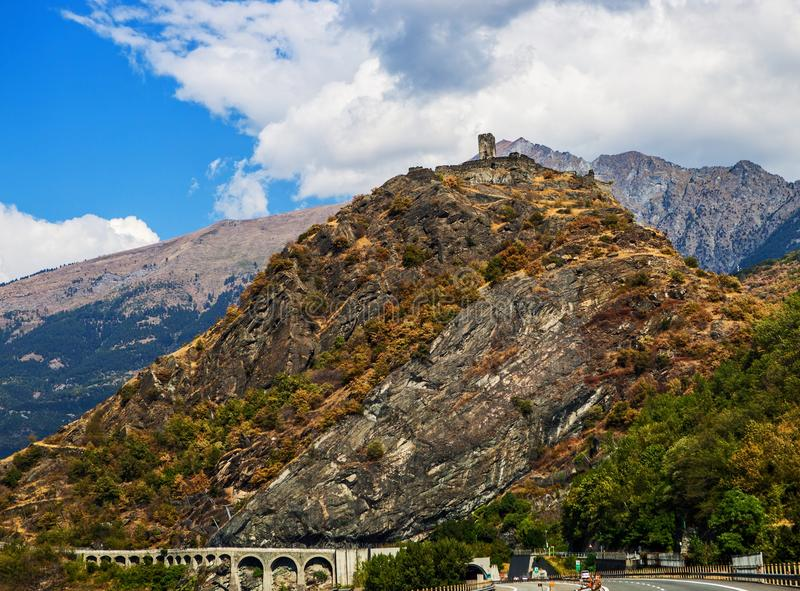 Hills of the Italian Alps with old castle on top royalty free stock photos