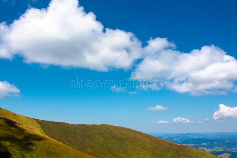 hills and meadows under the blue sky with clouds stock photo
