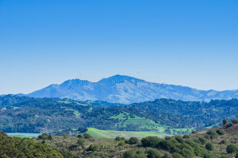 Hills and meadows in Wildcat Canyon Regional Park; San Pablo Reservoir; Mount Diablo in the background, east San Francisco bay,. Contra Costa county, California royalty free stock image