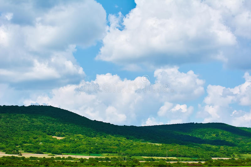Hills under the Cloudy Sky. Green Hills under the Cloudy Sky stock photo
