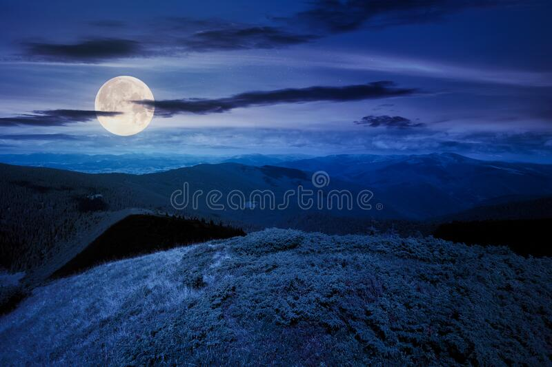 hills and valley of mountain landscape at night stock photo