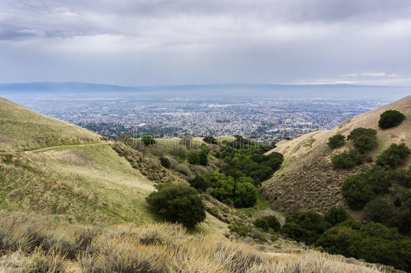 Aerial view of San Jose, California. Hills and valleys in Alum Rock Park on a rainy day; San Jose, California in the background stock image