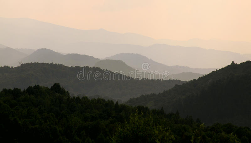 Hills and valleys in colors. Hills and valleys at sunset, in Transylvania stock image