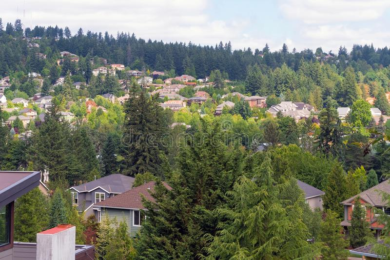 Hillside Homes in Suburban residential Neighborhood. Hillside luxury homes in Happy Valley Oregon North American suburban residential neighborhood royalty free stock photo