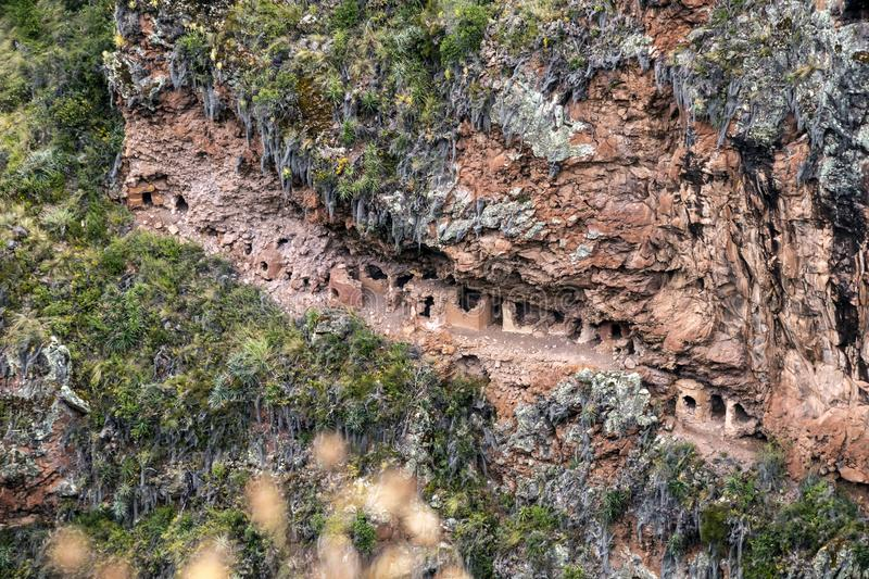 Hillside tombs at the biggest cemetery from Incan time, Pisac Inca Ruins in the Sacred Valley of the Incas, Cusco, Peru stock images