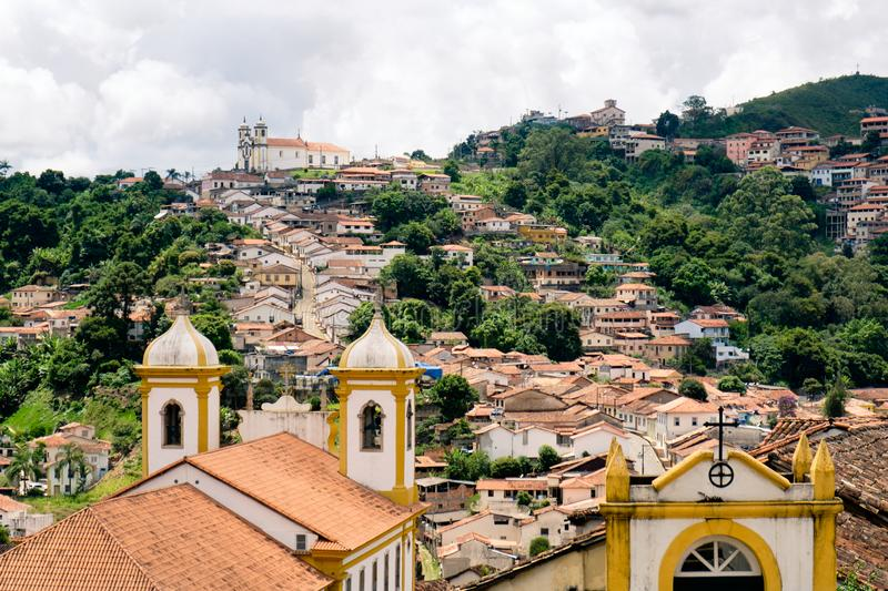 The hillside town of Ouro Preto in Brazil. View over the rooftops and churches of the old gold mining town of Ouro Preto in Brazil royalty free stock image