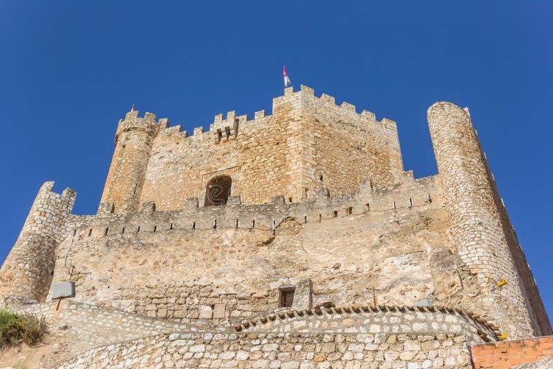 Hilltop castle of historic village Alcala del Jucar. Spain royalty free stock photography