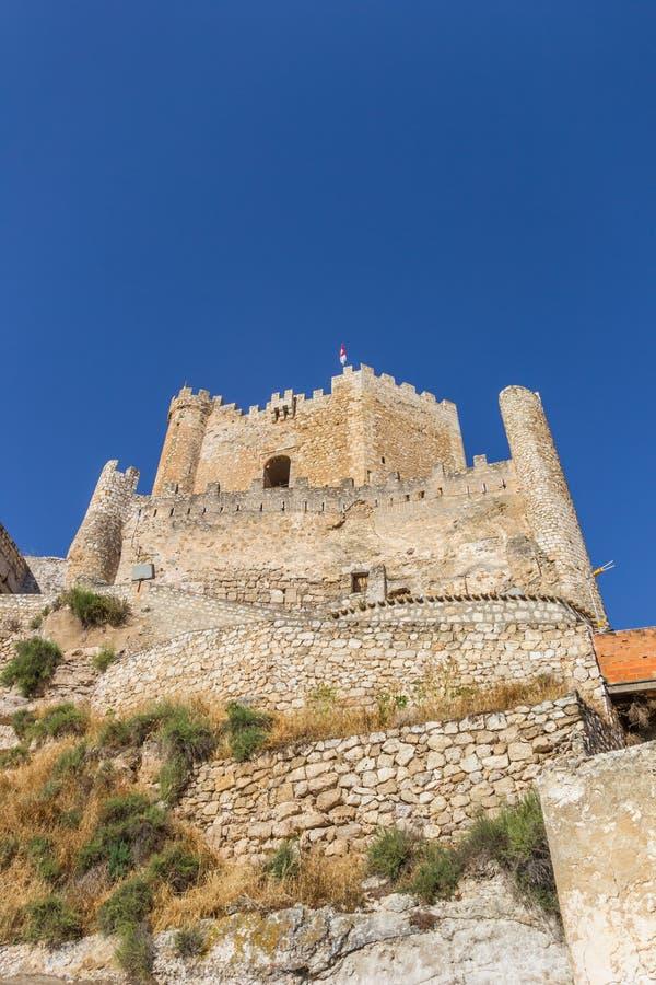 Hilltop castle of historic village Alcala del Jucar. Spain royalty free stock images