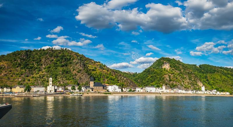 Hilltop castle and houses on Rhine River, Germany stock images