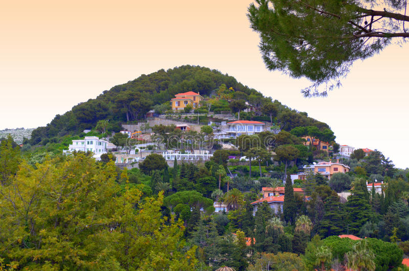 Hilltop houses,Bordighera Italy. Hilltop residential area at Bordighera town vicinity,Bordighera is a town and commune in the Province of Imperia, Liguria Italy royalty free stock photos