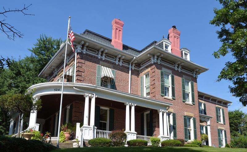 Hilltop Italianate. This is a Summer picture of a hilltop house overlooking the Mississippi River located in Keokuk, Iowa. The house built in 1850 is an example royalty free stock image