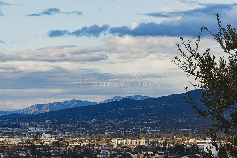 Hilltop view of burbank and san fernando valley, san gabriel mountains with cloudscape stock photography