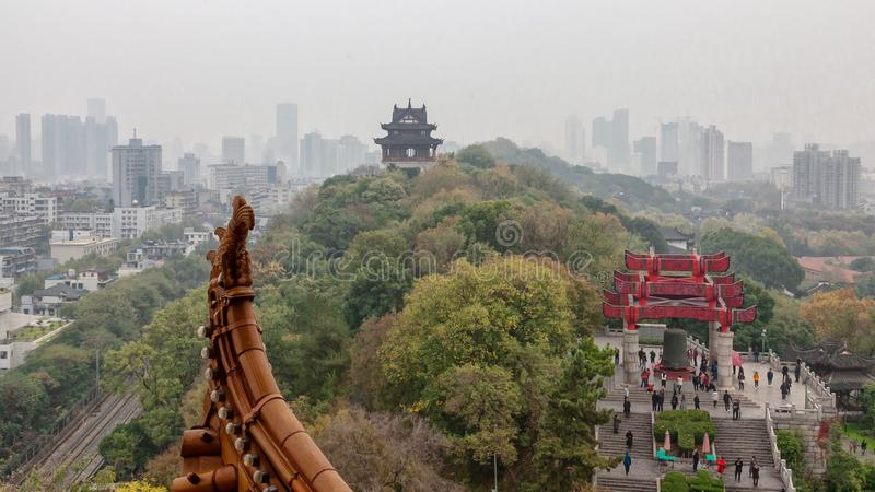 Hilltop vista in Wuhan, China. A hilltop cityscape vista from the Yellow Crane Tower in Wuhan, China, on a cloudy November day royalty free stock images