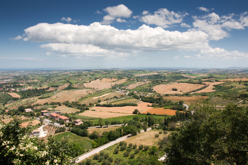 Hilly countryside of le Marche, Italy. With view to the sea at the horizon stock photography