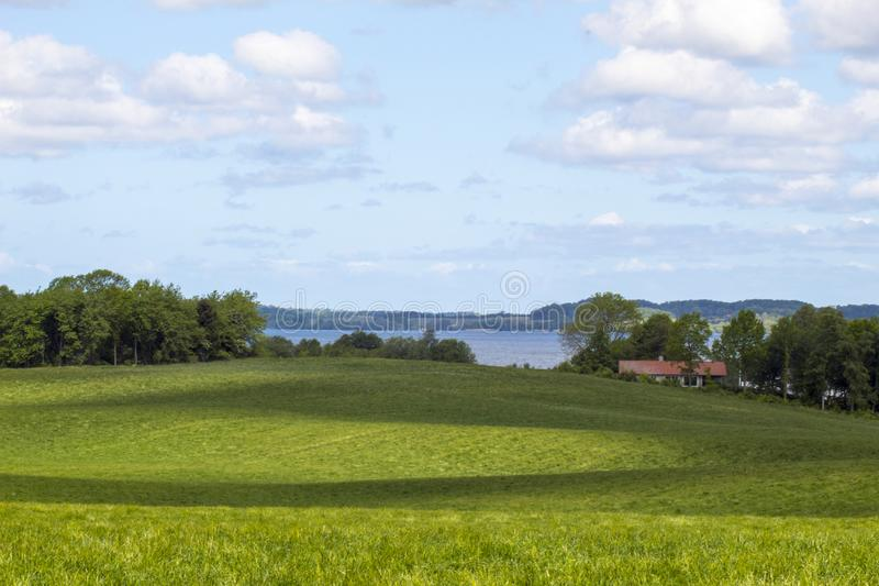 Hilly landscape fredensborg denmark. A hilly landscape in fredensborg denmark with a lake in the background stock photos