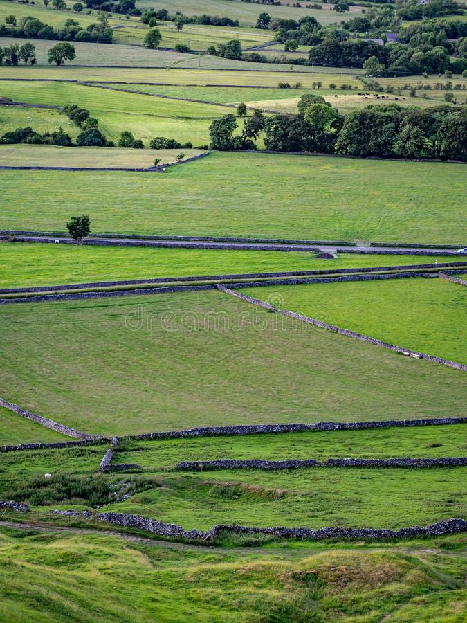Hilly landscape in the Peak District in the UK with stone fences. Dividing property stock photography