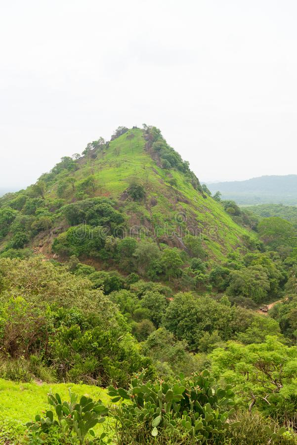 Hilly landscape view from sacred Dambulla Golden Cave Temple. Hilly rural landscape view from the top of sacred Dambulla Golden Cave Temple on Sri Lanka island stock photography