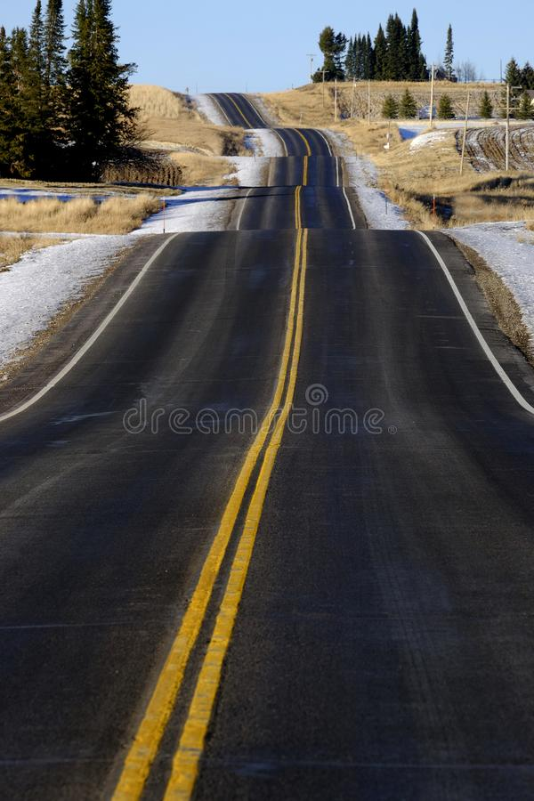 Hilly Road Transportation and Travel Double Yellow Lines Roadway stock photos