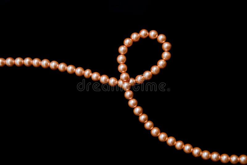 Hilo de la decoración de perlas anaranjadas imagenes de archivo