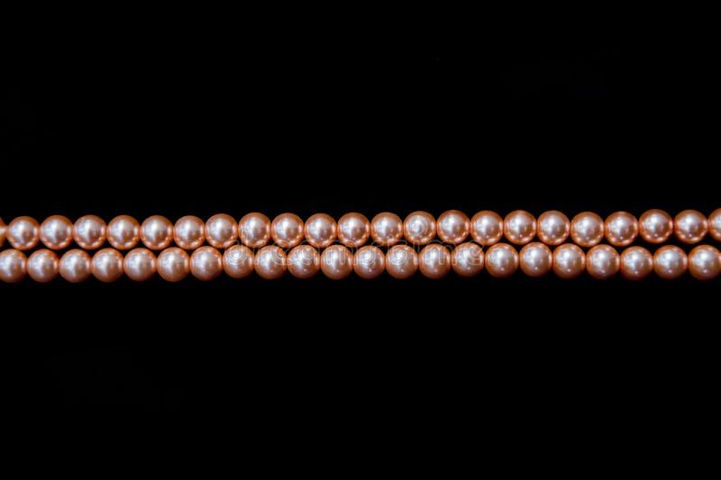 Hilo doble de perlas anaranjadas fotografía de archivo libre de regalías