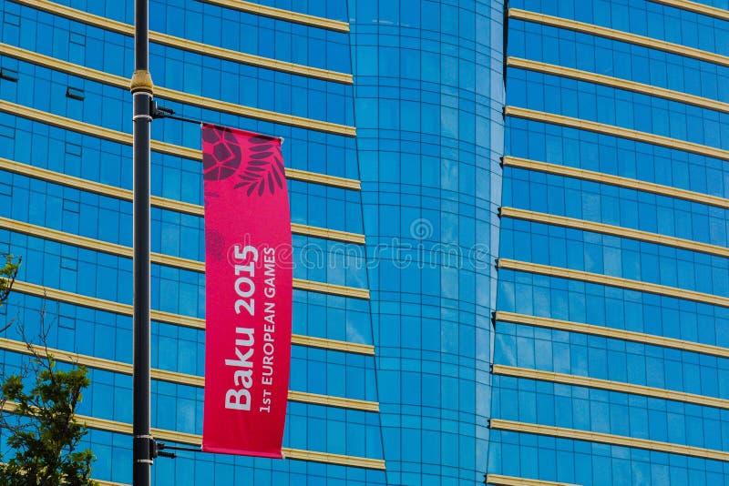 Hilton Hotel, cartaz vermelho dos jogos europeus no fundo azul fotografia de stock royalty free