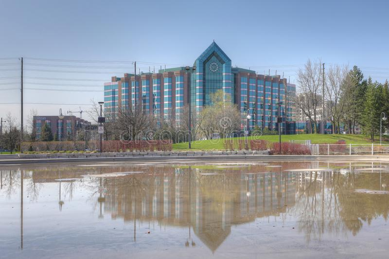 Hilton Hotel and reflecting pool in Markham, Canada. The Hilton Hotel and reflecting pool in Markham, Canada royalty free stock image