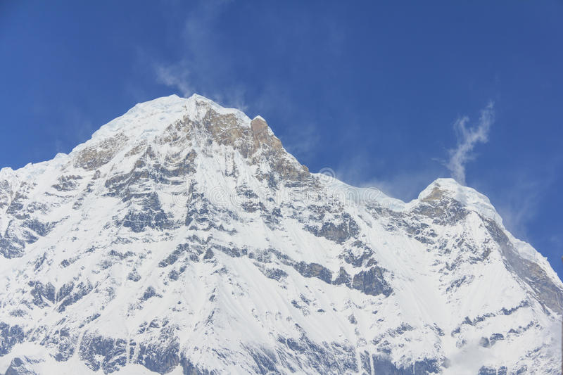 Himalaya Annapurna South, snow mountain peak in blue sky, Nepal royalty free stock images