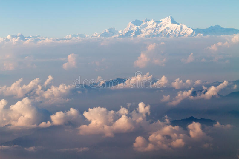 Himalaya mountains. Plane aerial view of himalaya mountains in the clouds royalty free stock photography