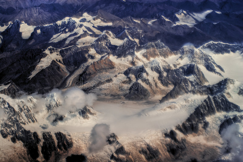 Himalaya mountains. Aerial view of snow covered Himalaya mountains royalty free stock photo