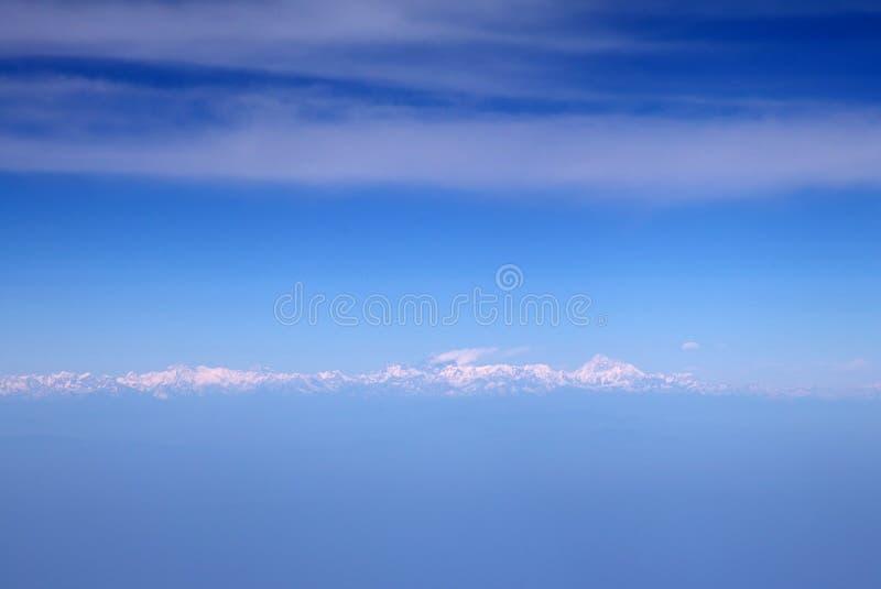 Himalaya mountains from the airplane. Himalaya mountains, in the clouds, view from the airplane royalty free stock photos