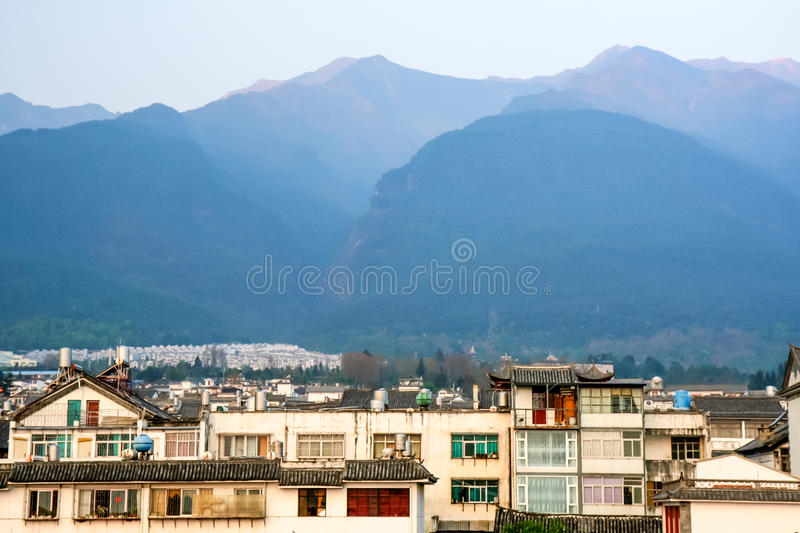 Himalaya mountains. Charming Chinese village at spring with Himalaya mountains in background stock photo