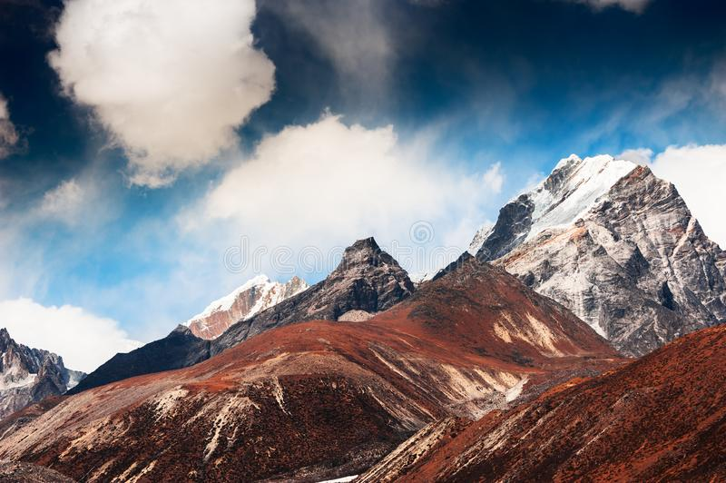 Himalaya mountains, Nepal. Himalaya mountains at altitude of 4500 m. Khumbu valley, Everest region, Nepal. Mountain range against the blue sky with clouds stock photography