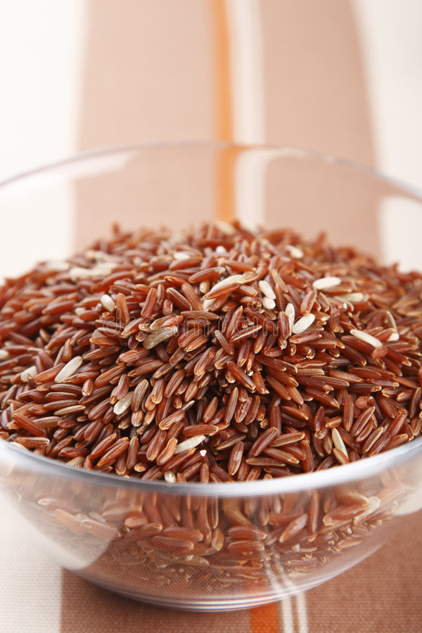 Himalayan Red Long grain Rice in glass bowl royalty free stock photo