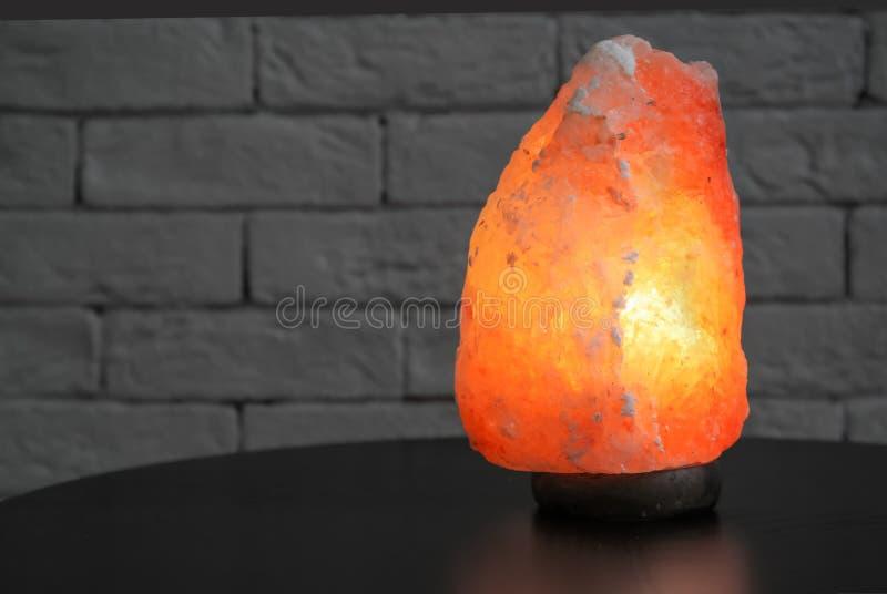 Himalayan salt lamp on table stock photo