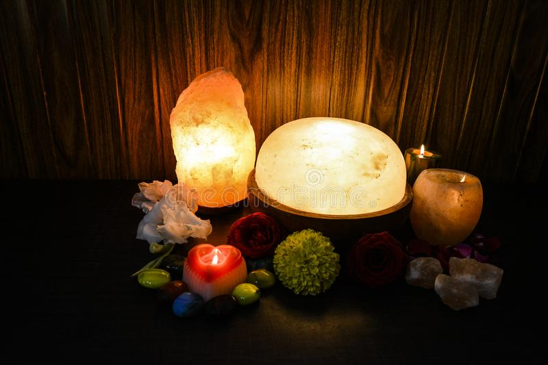 Himalayan Salt Lamps | Natural, Candle Holder & Foot Detoxer. Himalayan Salt Lamps | Foot Dexot, Candle Holder & Natural Lamp with wooden background. Foot royalty free stock photo