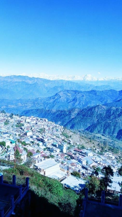 Himalayas Mountains Range Of India in Daylight View Uttrakhand travel tourism india. Himalayas Mountains Range Of India in Daylight Picture, broken, houses stock image