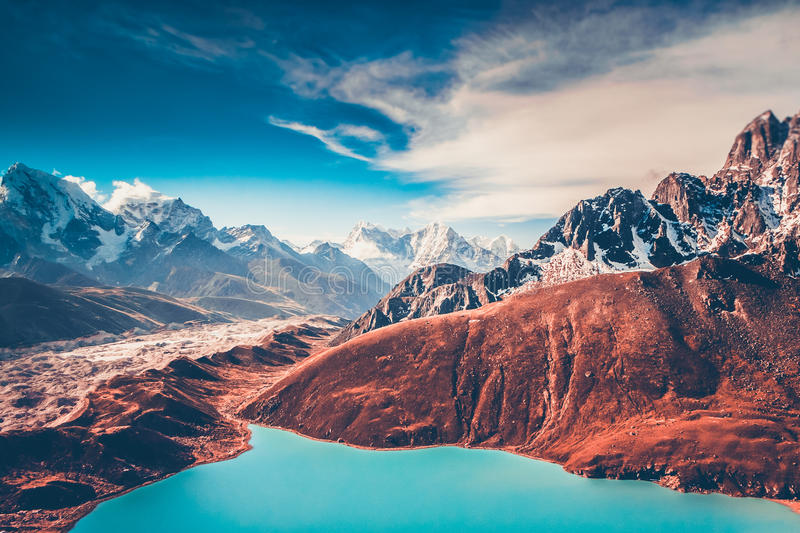 Himalayas. View from Gokyo Ri. 5360 meters up in the Himalaya Mountains of Nepal, snow covered high peaks and lake not far from Everest royalty free stock image