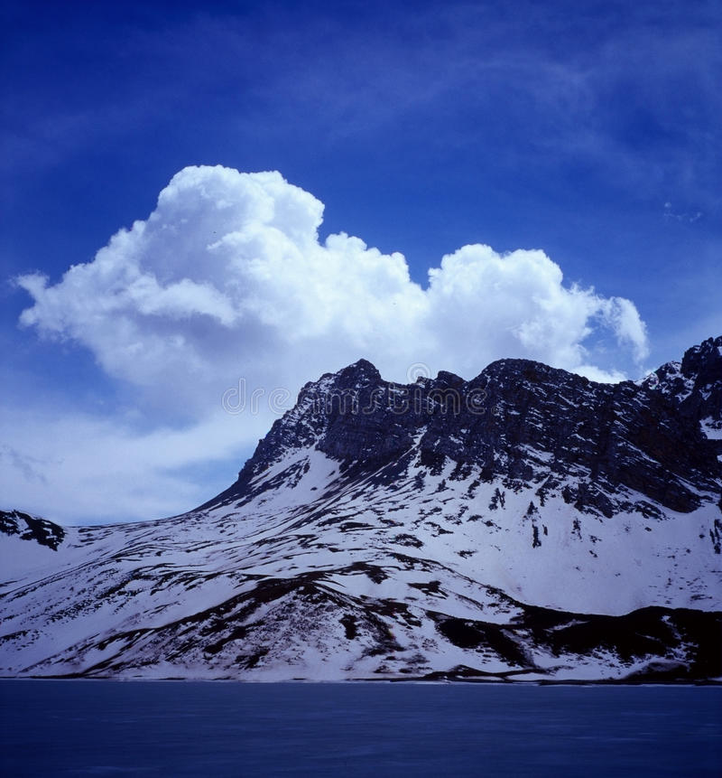 Himalchuli with clouds stock photo