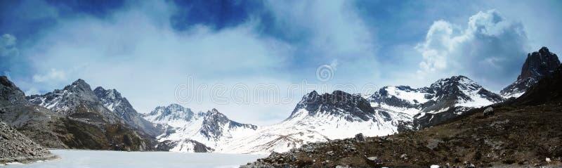 Himalchuli and frozen lake royalty free stock image