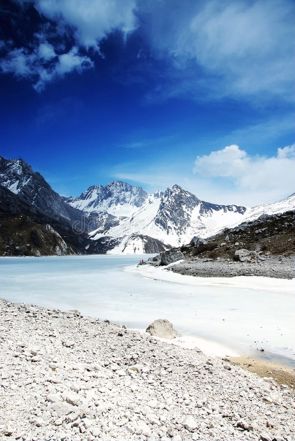 Himalchuli and frozen lake stock images