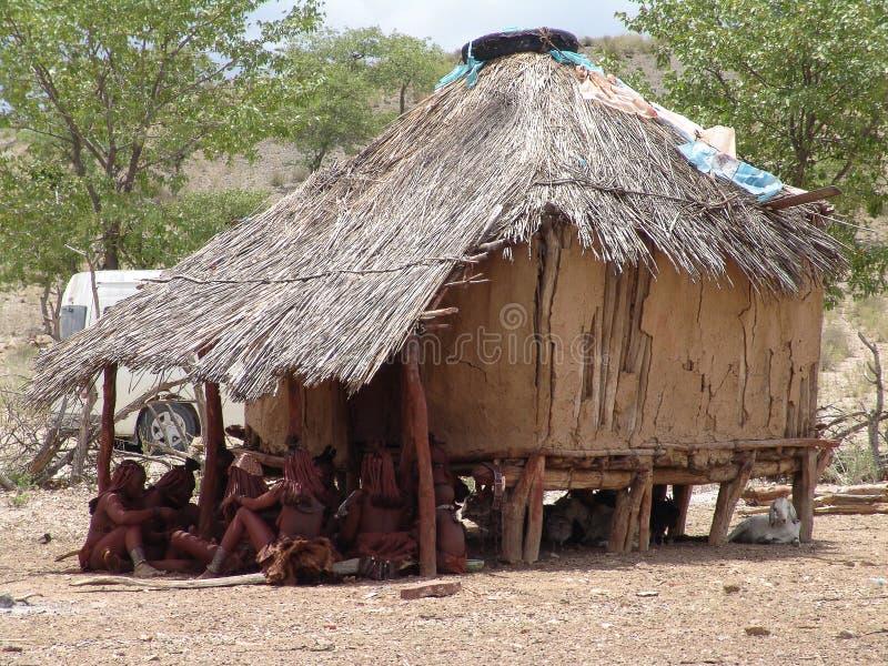 Himba people near the hovel stock photos