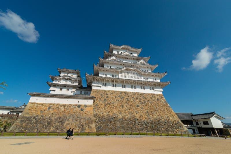 Himeji Castle fortification against blue skies in Himeji, Hyogo royalty free stock photo