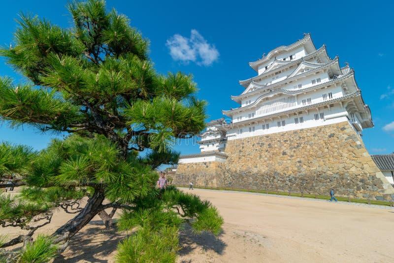 HIMEJI, HYOGO PREFECTURE-NOVEMBER 10, 2018 : Himeji Castle fortification against blue skies in Himeji, Hyogo Prefecture, Japan. royalty free stock image