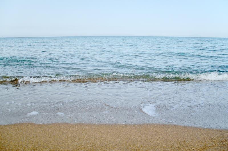 Himmel, hav och sand arkivbilder
