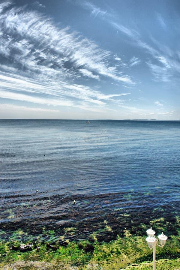 Himmel, Meer und Erde lizenzfreie stockfotografie
