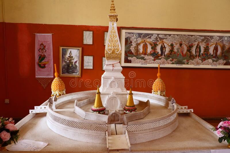 Hinayana Buddha temple, Sarnath. Inner view of the Thai Temple, the Hinayana Buddha temple at Sarnath with the statue of Lord Buddha & others stock photo