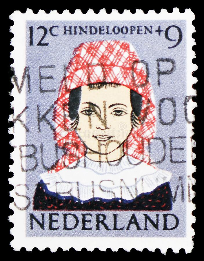 Hindeloopen costume, Children Stamps serie, circa 1960 stock photography