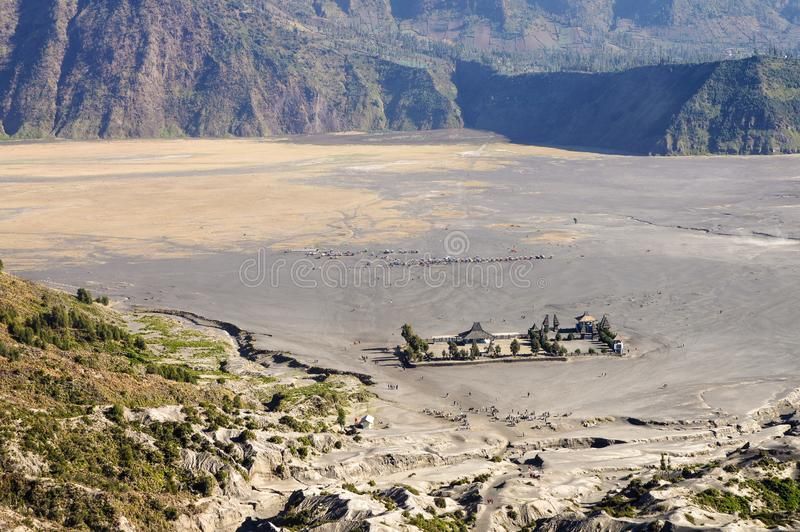 Hindo temple in caldera of old volcano Tengger, Bromo Tengger Se. Meru National Park, East Java, Indonesia. Iin the distance you can see the parking of jeeps royalty free stock photo