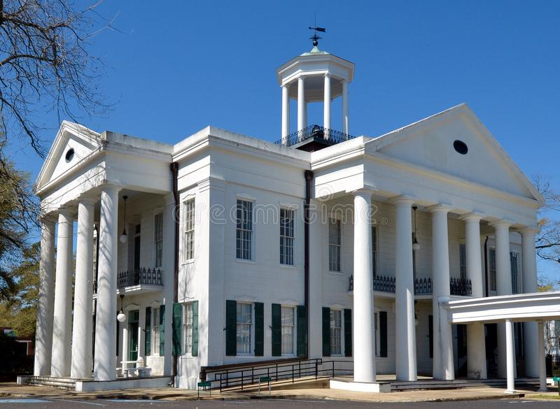 Hinds County Courthouse. This is a Spring picture of the Hinds County Courthouse in Raymond, Mississippi. The courthouse was designed by Geoege and Thomas Weldon royalty free stock photo