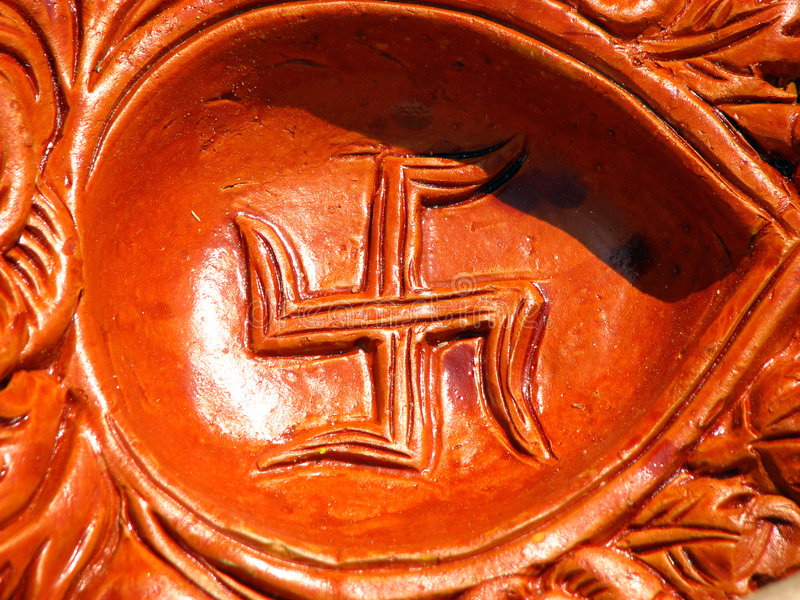 Hindu Art. A traditional hindu background with swastika carved on an earthen lamps on a festive occasion in India royalty free stock photos